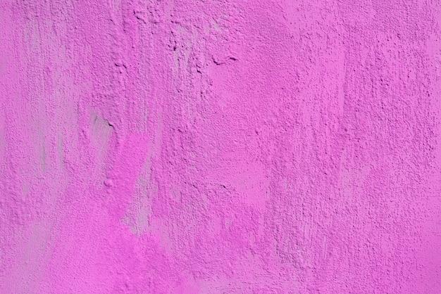 Textuur van ruwe roze gips. architecturale abstracte achtergrond.