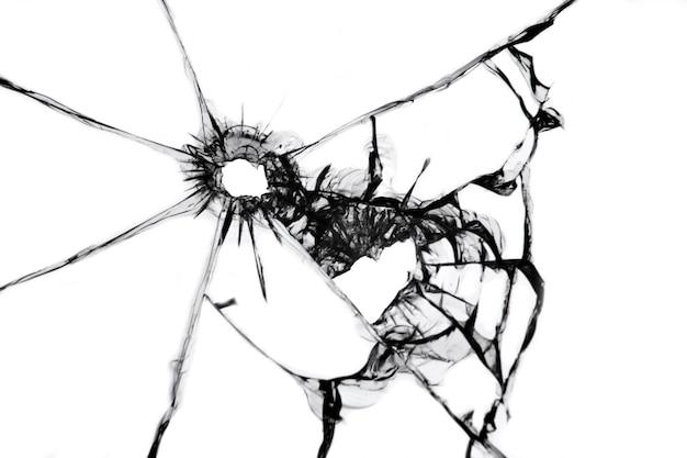 Textuur van scheuren van een schot in het raam. gebroken glaseffect dat op witte achtergrond wordt geïsoleerd.