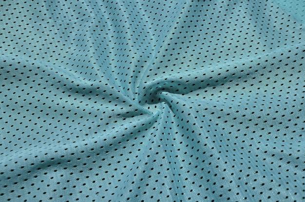 Textuur van sportkleding gemaakt van polyestervezel. bovenkleding voor sporttraining heeft een maasstructuur van rekbaar nylon