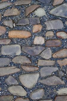 Textuur van stenen bestrating tegels keien bakstenen achtergrond