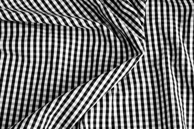 Textuur van stof in een kooi. zwart en wit geruite stof.