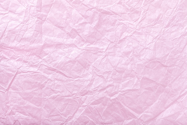 Textuur van verfrommeld roze verpakkend document, close-up