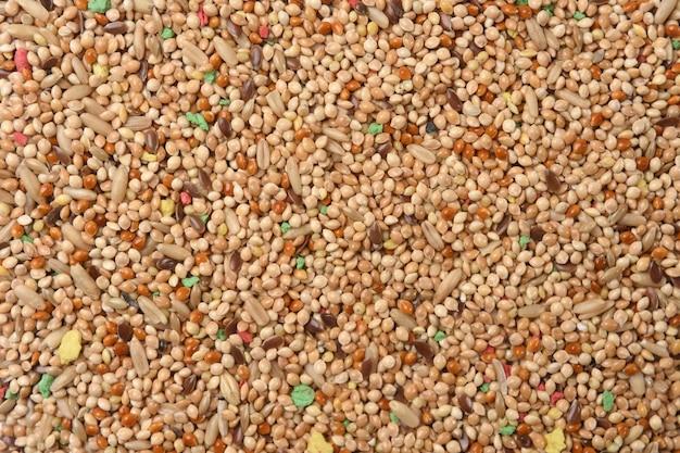 Textuur van voedsel voor parkietenmengsel van granen