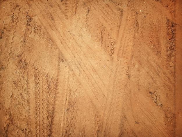 Textuur van wielspoor op grondachtergrond