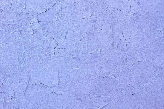 Textuur van witte oude cementmuur met scheuren.