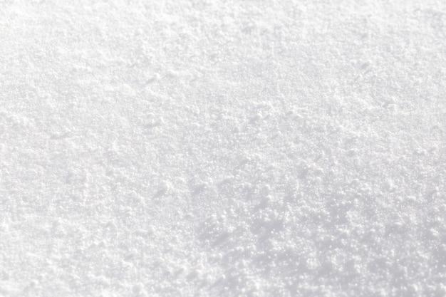 Textuur van witte sneeuw die in de zon fonkelt.