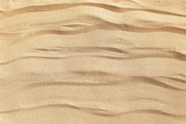 Textuur van zeezand in de vorm van golven