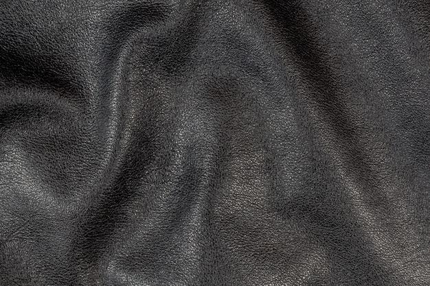 Textuur van zwart leer.