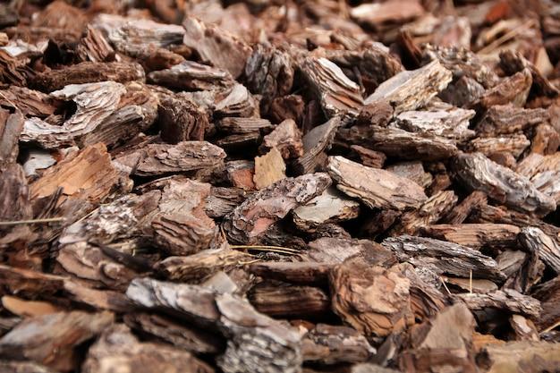 Textuur verpletterde fragmenten schors van hout.
