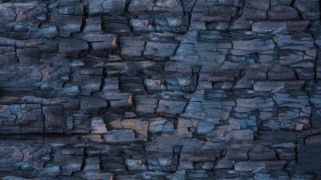 Textuur zwart hout gebroken voor achtergrond of behang