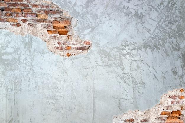 Textuurachtergrond van cementmuren en oude baksteenbarsten in de muur
