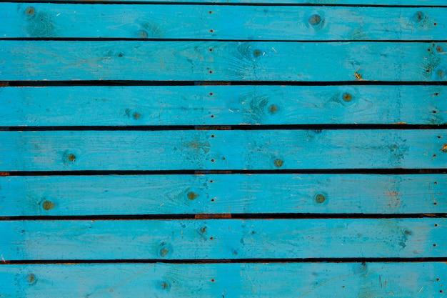 Textuurachtergrond van oude houten muur die in blauwe kleur wordt geschilderd