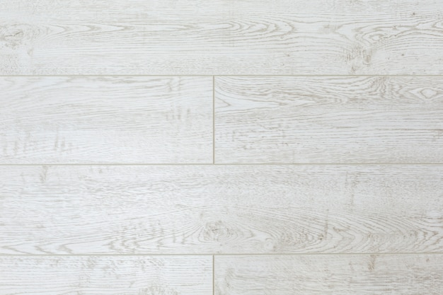 Textuurachtergrond van witte raad op de vloer