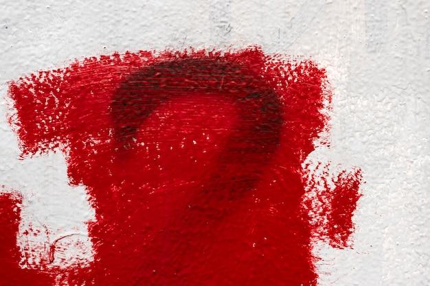 Textuurmuur, druppelverf, stopverf, rood-witte muur
