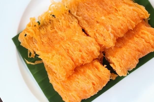 Thais dessert, gouden draden.