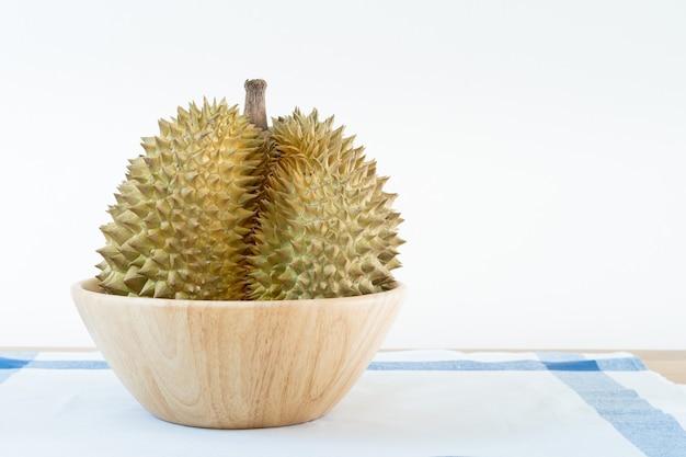 Thais durian-fruit op de houten lijst met lege zwarte raads dichte omhooggaand met exemplaarruimte.