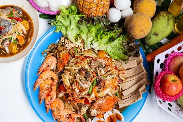 Thais eten papaya salade