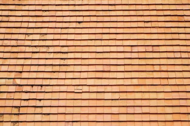 The clay roof tiles of a house op het platteland van thailand