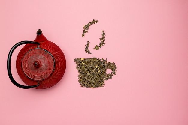 Theekoppictogram gemaakt van droge oolong-theebladen