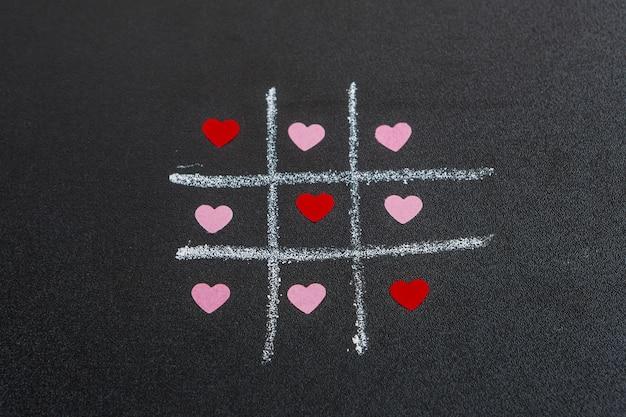 Tic tac toe spel met ornament harten