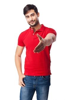 Tiener met uitgestoken hand op een witte achtergrond