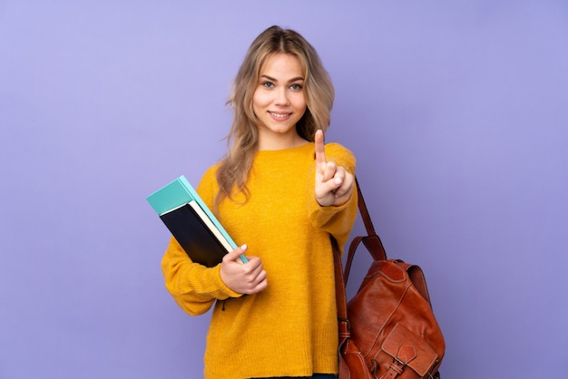 Tiener student meisje op paars tonen en een vinger opheffen