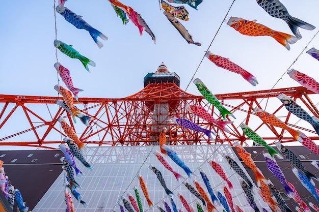 Tokyo tower met koinoborii in japan looking from bottom