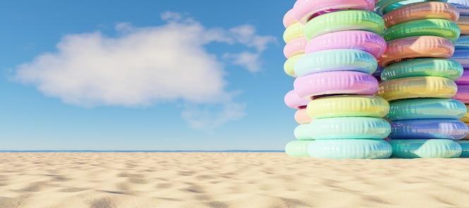 Toren van opblaasbare ringen op het strand