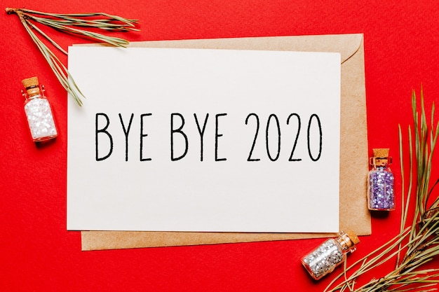 Tot ziens 2020 kerstnota met spartak op rood nieuwjaarsconcept
