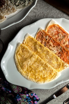Traditionele qutab gevuld met vlees en pompoen