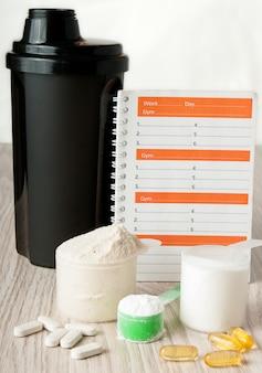Trainingsdagboek en fitnessdagboek om resultaten te registreren.