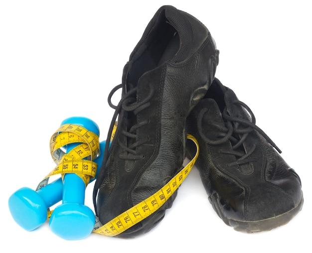 Trainingsschoenen met meetlint en halters