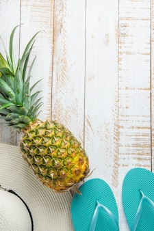 Tropical fruits pineapple women hat blue slippers on white