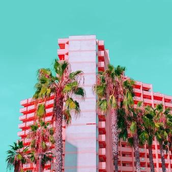 Tropische mode eenhoorn minimaal. palmen en hotel. stijlvol kleurontwerp