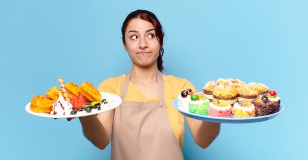 Tty bakkerijmedewerker vrouw met wafels en gebak