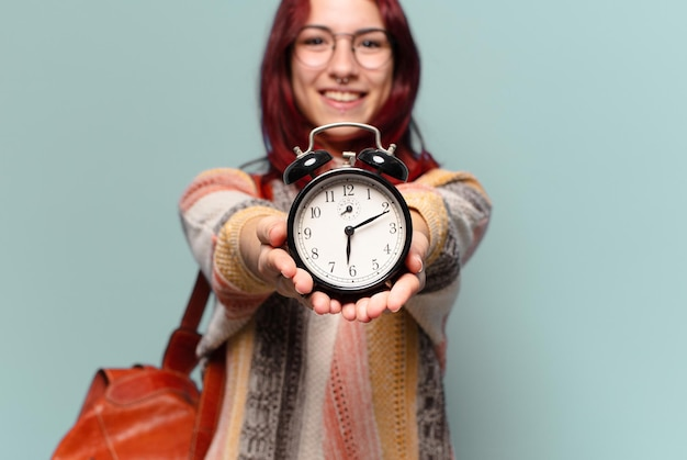 Tty studentenvrouw met een wekker