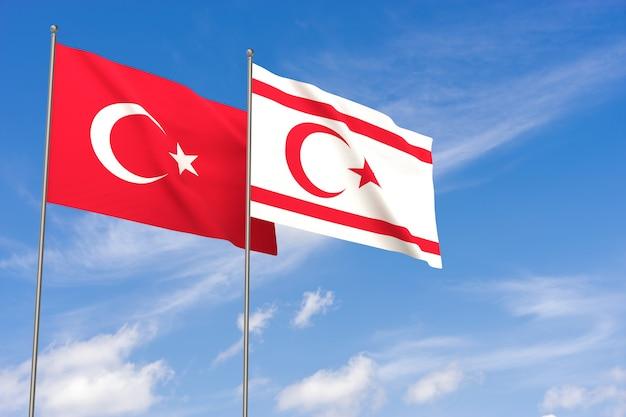 Turkije en de turkse republiek noord-cyprus vlaggen over blauwe hemelachtergrond. 3d illustratie
