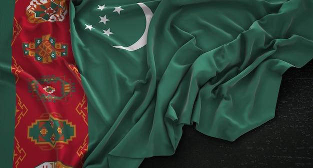 Turkmenistan vlag gerimpeld op donkere achtergrond 3d render
