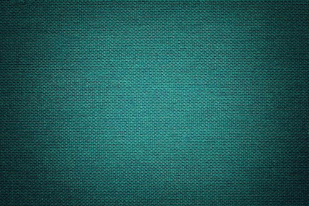 Turkooise achtergrond van een textielproduct met rieten patroon, close-up.