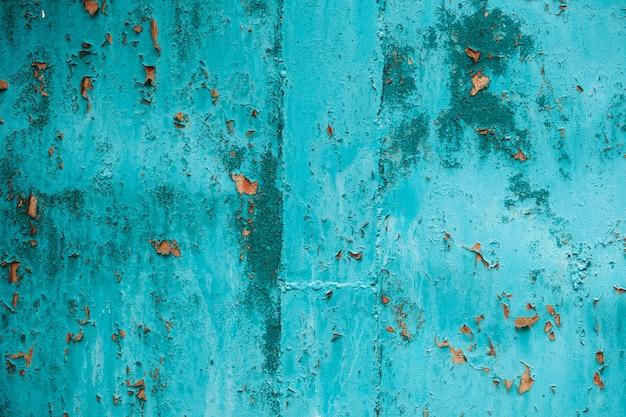 Turqouise grunge muur met krassen, slijtage en roest. behang, textuur achtergrond.