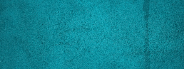 Turquoise achtergrond natuurlijk suède met een donkere rand en een licht centrum. horizontale webbanner.