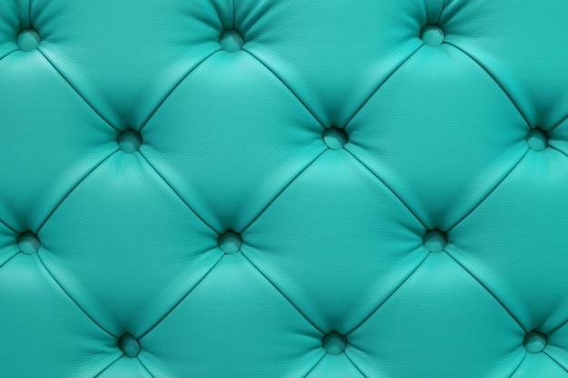 Turquoise leren sofa gestikte knopen.