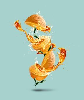 Tussen sinaasappels zit een scheutje sap. de compositie is vergelijkbaar met een boom of bloem.