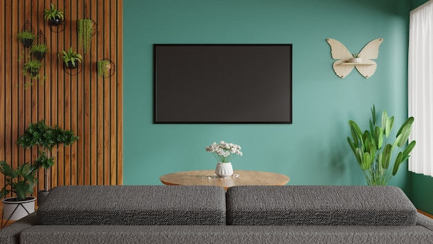 Tv-kamer heeft een decoratieve plant aan de zijkant, een bank vooraan en een grote tv aan de prachtige groene muur. 3d rendering.