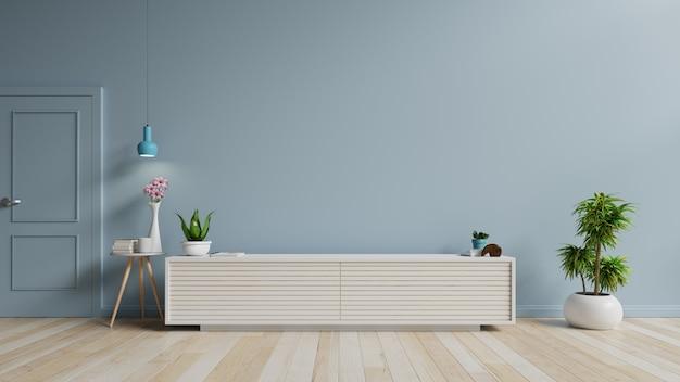 Tv-kast in moderne lege ruimte op blauwe muur.