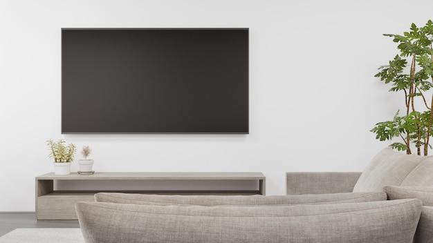 Tv-standaard op betonnen vloer van lichte woonkamer en bank tegen televisie in moderne woning of appartement.