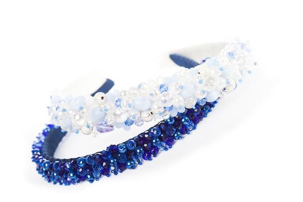 Twee blauwe sieradenhoofdbanden voor vrouwelijk haar