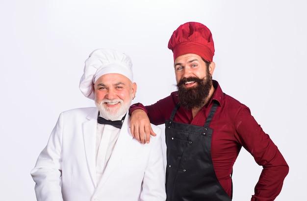 Twee chef-koks op keukenchefs in uniforme chef-kok voor gezonde voeding en professionele culinaire professional