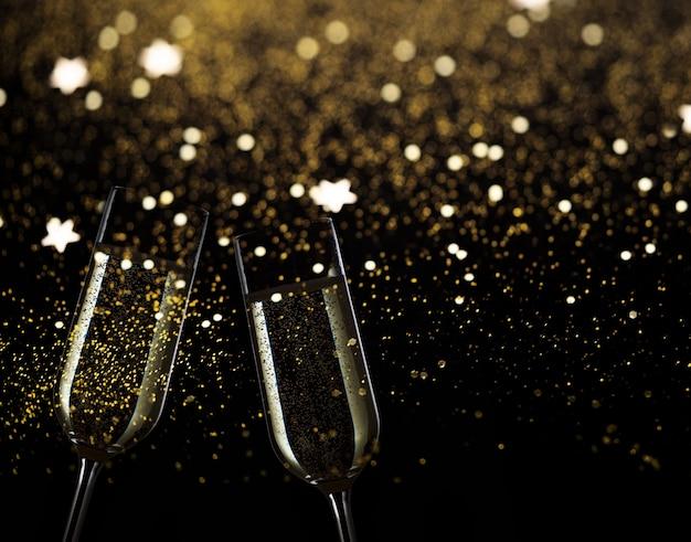 Twee feestelijke champagneglazen op zwarte achtergrond met gouden bokehlichten en fonkelingen