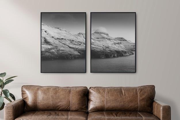Twee frames bij een bank in een luxe woonkamer in industriële stijl